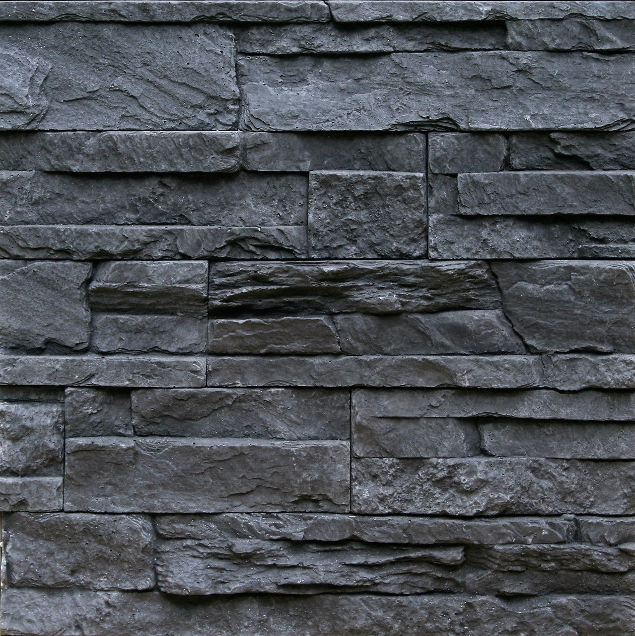 textured stone backsplash
